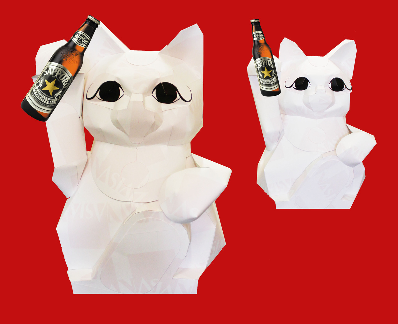 "Local artists Charlene Tan and SpaceBi made these 4-ft tall maneki neko cats out of the Asian Art Museum's old letterhead (which were rendered obsolete by our new brand identity). Very clever recycling of something that otherwise would've gone straight to the recycling bin. After the paper cats were created, they were ""unofficially"" staged on our entrance during one of our free days. What a massive hit, especially for many of the families who wait in line to get into the museum.  Here, the cats are holding brewskies because tonight at MATCHA (our art carnival-esque event with SpaceBi). the first 200 people who enter our doors get a drink ticket for a free Sapporo beer.  Click here to find out more about the cats and how they were made."