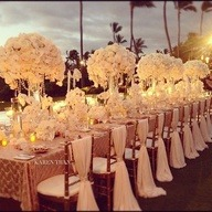 Gorgeous candle lit table and chairs.  So elegant and romantic.  Definitely what I dream of as the perfect wedding table setting.