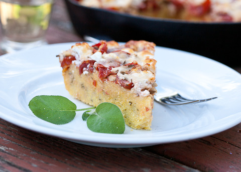 foodopia:  Top polenta with sun-ripened tomatoes, garlic, sage, pine nuts, and goat cheese in a cast iron skillet for a simple, comforting meal.