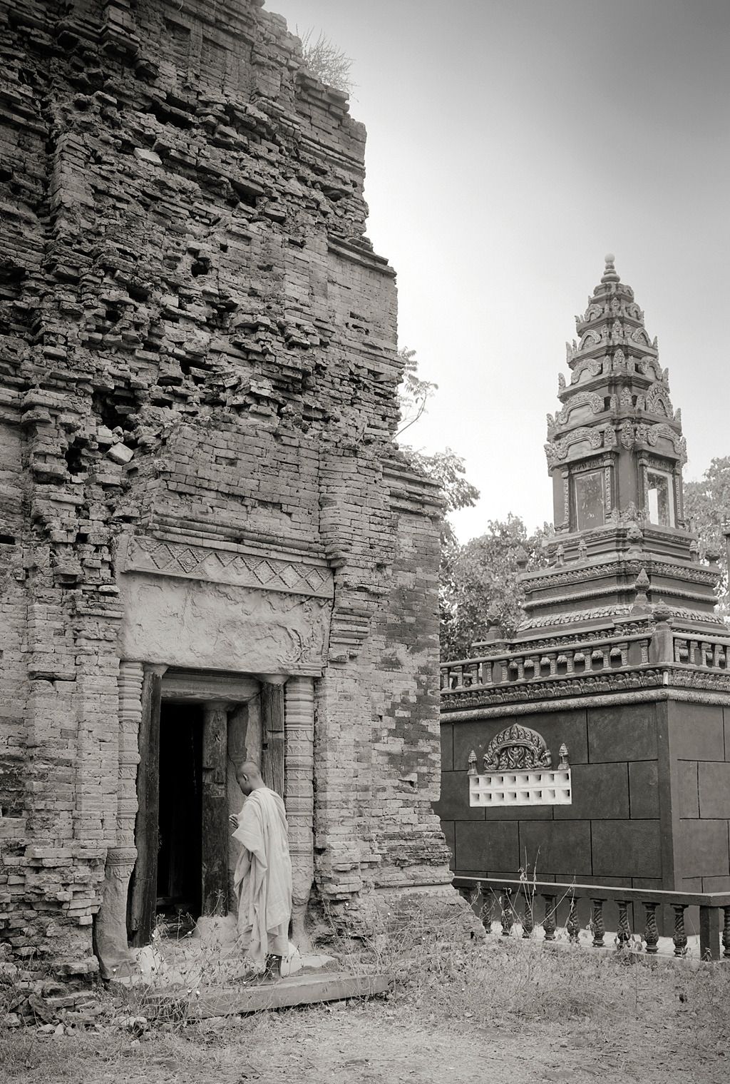 "An incredible series of photographs by Kenro Izu of Cambodia's undiscovered ancient temples. The one above, Prasat Neang Khmau, was built in the tenth century and ""is also known as the Temple of the Black Lady—its name perhaps alludes to Kali, the dark goddess of destruction."" (via condenasttraveler) ~Trent Gilliss, senior editor"