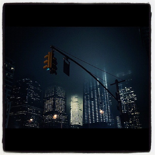 The city, a few mins ago. #manhattan #nyc #newyork #statigram #now #newyorkcity #lowermahattan #hail #instagrammers #instago #freedomtower #rainstorm #storm #wtc #worldtradecenter #fog #lightning #bestogram #photo #pic #city #instafamous #scary #weather #igers #lovenyc #dark (Taken with Instagram at Nassau St)