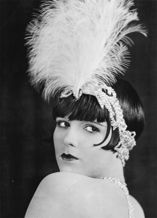 silentmovies:  Louise Brooks, The American Venus, 1927  makes me sad this film is lost and that i have never seen it. also this makes me sad because of that time i tried on a fancy hat thing with an ostrich feather but it was so fucking expensive it broke my heart.