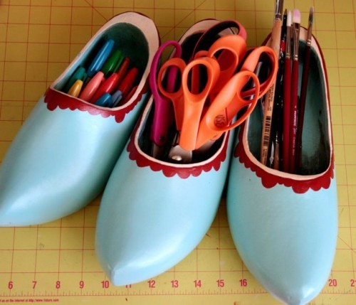 Painted clogs used to organize art supplies From Shelterness