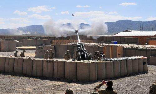semperannoying:  PAKTIKA PROVINCE, Afghanistan – During a joint live fire exercise July 19, the Battery A, 2nd Battalion, 32nd Field Artillery, 4th Infantry Brigade Combat Team, 1st Infantry Division, fires a M777A2 155 mm Howitzer in conjuction with a D30 used by the 3rd Kandak, 2nd Brigade, 203rd Corps, Afghan National Army.