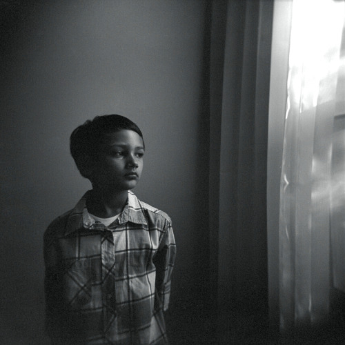 ericahamptonphotography:  Xander Brody by the window, July 2012 Holga, Tri X 400