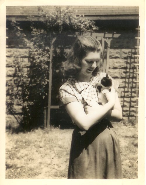 fromaravenswritingdesk:  My grandmother looking all adorable with a cat.