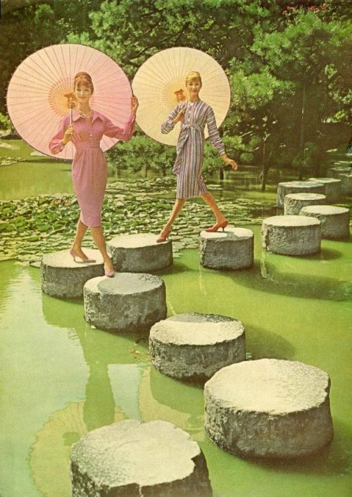 Early 1960s fashion with parasols.