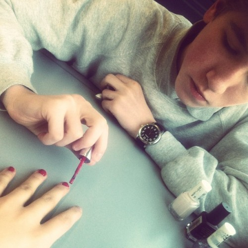 Dom painting Alice's nails.