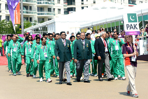 Pakistan's flag was raised at the Olympic village on Wednesday, July 25, two days before the London Olympics officially start. Officials and athletes from Pakistan participated in the flag raising ceremony where flags of other participating countries were also hoisted. -Photos by AFP Follow us on Facebook | Twitter or Submit something or Just Ask!