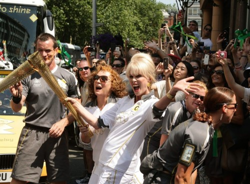 suicideblonde:  Joanna Lumley and Jennifer Saunders carry the Olympic Flame on the Torch Relay leg between Lambeth and Kensington and Chelsea, in London, July 26th DEFINITIVE PICTURE OF THE TORCH RELAY, DARLING