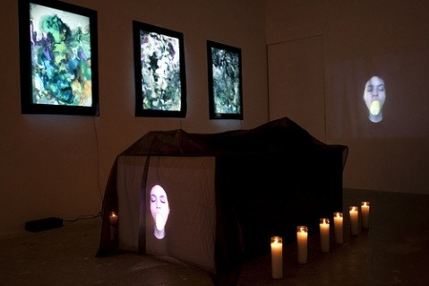 Performance artists Escobar-Morales perform a funerary ritual, referencing the mythical Mayan tale of the Hero Twins reviving their dead father, the Maize God. In their contemporary interpretation of this ancient story, Escobar-Morales simultaneously represent the body and the soul; the God/ Goddess and twin offspring, in both physical and technological forms using live performance and web based video projection. Performed at Jolie-Laide gallery in Philadelphia. (via Escobar-Morales: Excerpts from the Ressurection of Hun-Nal-Ye « Maya Talk)