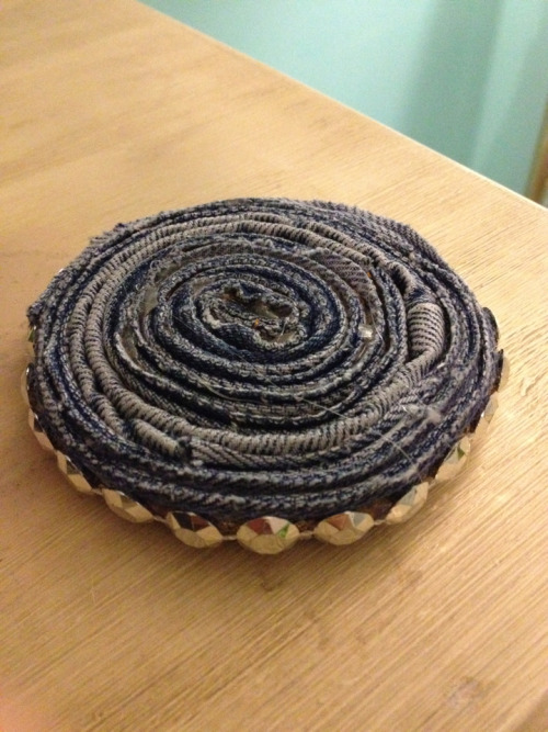 jessigx3:  Blue jean coaster! Cut off the hems on each side of a leg of jeans then swirl them together with hot glue. Add something decorative for the outside. :)