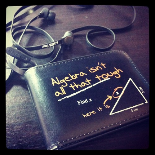 niallhorangirlfriend:  Algebra isn't all that tough. #algebra #maths #wallet #earpiece #money #jays #black (Taken with Instagram)