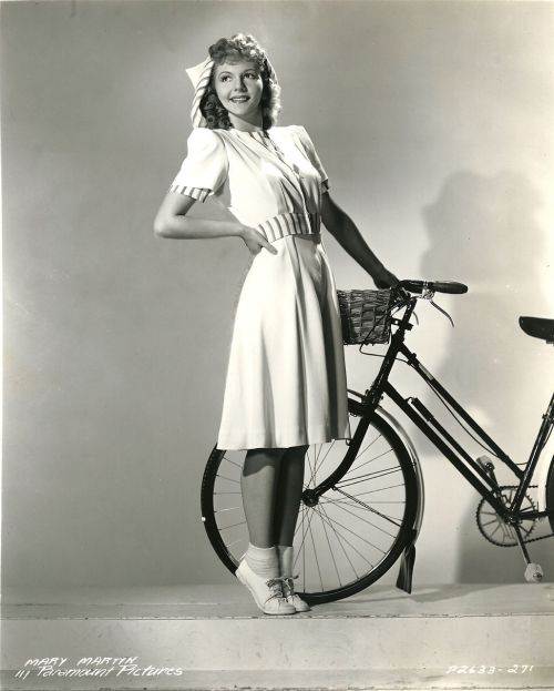Mary Martin tiptoes a bike.