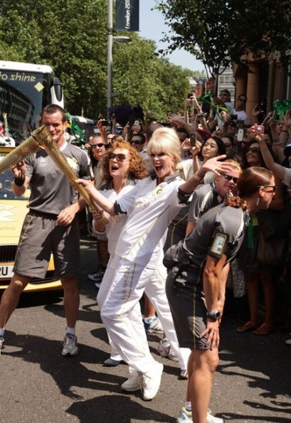 The AbFab ladies run the torch Photo: PA