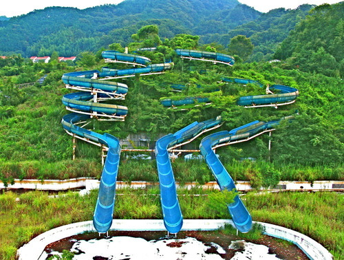"abandonedporn:  Sports World - Abadoned Water Park in Izu, Japan  by Michaeljohngrist  I heard of a lot of different parks like this built during the ""Bubble"" of economic prosperity in Japan at the end of the 80s. If you've ever wondered about the kind of casual way the weird, in-the-middle-of-nowhere resort is treated at the beginning of Spirited Away? This is that."