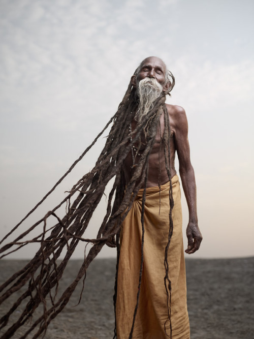 """Lal Baba has dreadlocks (jatas) several meters long, which have been growing for over 40 years. To sadhus, dreadlocks are a sign of renunciation and a life dedicated to spirituality. Varanasi, India"" -Joey Lawrence So AWESOME!"