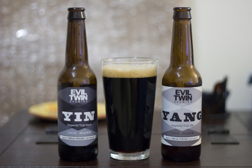 thegreatbeerquest:  Review: Evil Twin Yin & Yang (Bottles) This is one of the coolest concepts I've come across in craft beer: two beers that can be tried separately, but are intended to be mixed to create an entirely new concoction. Yang is an Imperial IPA and Yin an Imperial Stout. Upon mixing they create what some call a black IPA, or perhaps a hoppy stout. Anyway I'll review each beer separately than the combo. Yang Very sweet honey aroma. The flavors are more reminiscent of a golden barleywine/strong ale with tons of caramel, honey, some peach/apricot, and finally a grapefruit finish with some rum heat.  8.75/10 Yin This stout is pretty fantastic: a complex and unique palate of molasses, oak, dark chocolate, vanilla, dark fruit, and a rich cake butter dessert character.  9.5/10 Yin & Yang Mixing the two beers creates a black beer the same color as Yin. Though I mixed them both equally, the flavors of Yin are more apparent. Dark chocolate is emphasized and some coffee notes suddenly become noticeable. These are mixed by tons of honey and caramel from the IPA, creating a sticky sweet stout. Tons of flavor, though the balance is a bit off. Still really good.  9.25/10