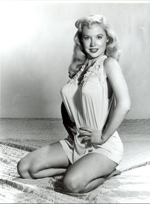 vintagechampagnefever:  Betty Brosmer makes a simple night gown look pronographic