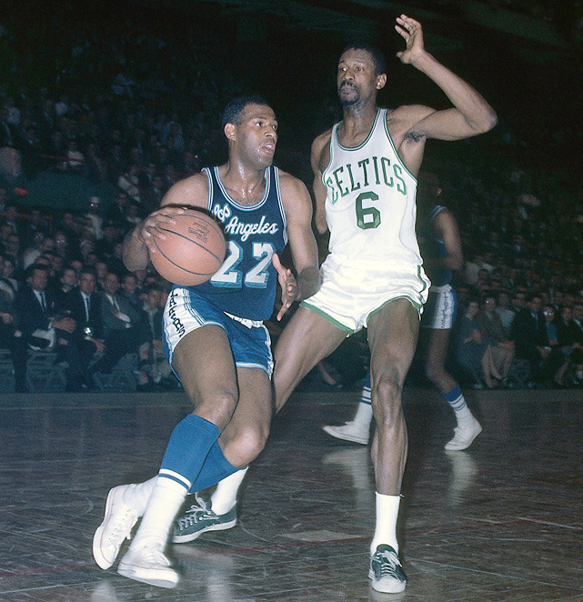 Hall of Famer Elgin Baylor dribbles up court against Bill Russell during a 1963 Celtics-Lakers game. Russell defeated Baylor's Lakers for seven of his 11 NBA championships. (Dick Raphael/NBAE/Getty Images) GALLERY: Rare Photos of Bill Russell | Iconic Lakers | Iconic Celtics