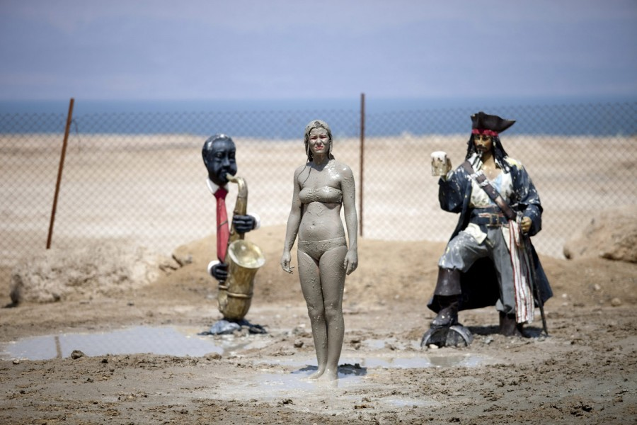 July 25 2012. A tourist smears herself with mud from the Dead Sea at a coastal resort near Ein Gedi, Israel. From drought-cracked earth in Yemen and massive floods in China to violent protests in California and Olympic preparation in London, TIME's photo department presents the best images of the week. See more photos here.