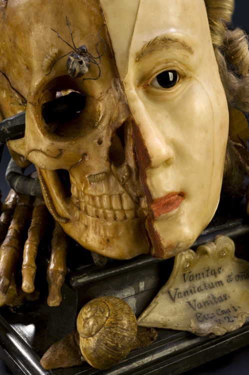 "ratak-monodosico:  Wax vanitas, Europe, 1701-1800  Vanitas are works of art intended to remind the viewer of the shortness of human life, the uselessness of vanity and the certainty of death. This example features many symbols typical for this type of object, such as a skull and insects that feast on decaying flesh. The other side of the model shows the face during life. The verse scratched on to the front is from the biblical book of Ecclesiastes and reads ""vanity of vanities, all is vanity""."