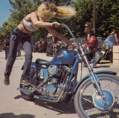 Some 70's Harley kickstarting bleach-blonde action.