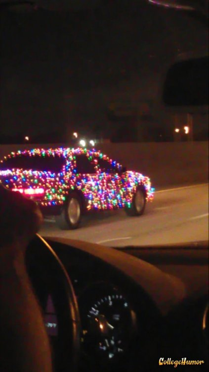 Car Covered in Colored Lights Who needs a paint job?