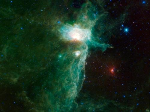 ulaulaman:  The Flame Nebula The Flame Nebula sits on the eastern hip of Orion the Hunter, a constellation most easily visible in the northern hemisphere during winter evenings. This view of the nebula was taken by WISE, NASA's Wide-field Infrared Survey Explorer. This image shows a vast cloud of gas and dust where new stars are being born. Three familiar nebulae are visible in the central region: the Flame Nebula, the Horsehead Nebula and NGC 2023. The Flame Nebula is the brightest and largest in the image. It is lit by a star inside it that is 20 times the mass of the sun and would be as bright to our eyes as the other stars in Orion's belt if it weren't for all the surrounding dust, which makes it appear 4 billion times dimmer than it actually is. Image Credit: NASA/JPL-Caltech/UCLA