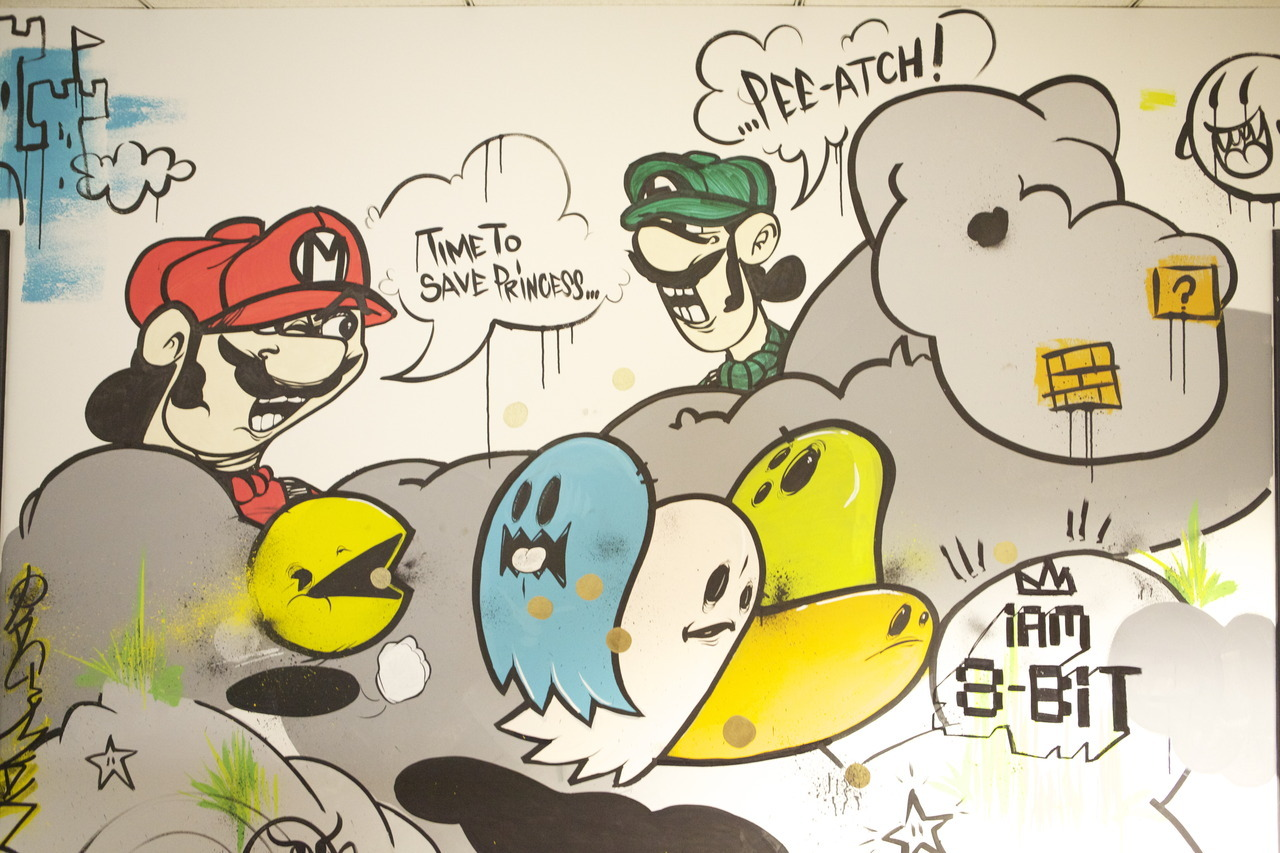 GT Office Muralby iam8bit Mario, Luigi, and Pac-Man in this section of the murals lining the GT offices.