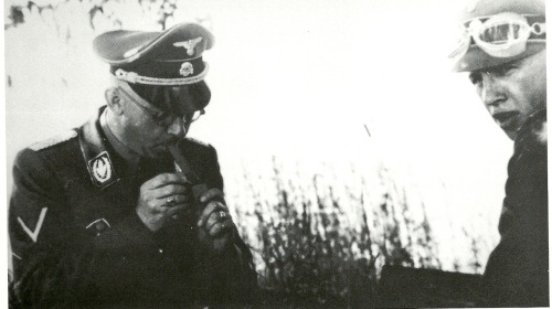 kathazahler:  Lighting up Himmler with a driver Bastian.  Bastian died of a self inflected wound caused from an accidental discharge of his gun when cleaning it.  From page 154 of Martin Mansson's book Heinrich Himmler: A Photographic Chronicle of Hitler's Reichführer-SS  owned by private collector