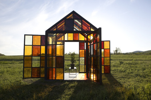 """Artist William Lamson created this prismatic greenhouse out of 162 panels of sugar cooked to different temperatures. Lamson bakes the sugar until is caramelizes, closely monitoring the color. He then pours the syrup onto a pane of heated glass and as it cools he places another piece of glass on top. The glass 'sandwich' is then sealed with silicone."""