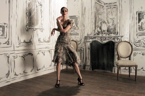 zacposen:  coco rocha posing and dancing during a video shoot with poppy de villeneuve. the set in the background was designed by her husband the talented james conran.