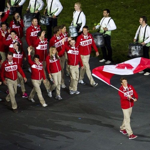 Simon Whitfield leads the Canadian athletes into the Olympic Stadium during the Opening Ceremonies for the 2012 Summer Olympic Games in London, England Friday, July 27, 2012. (Kevin Van Paassen/The Globe and Mail) #olympics #london2012 #canada #flag#photojournalism