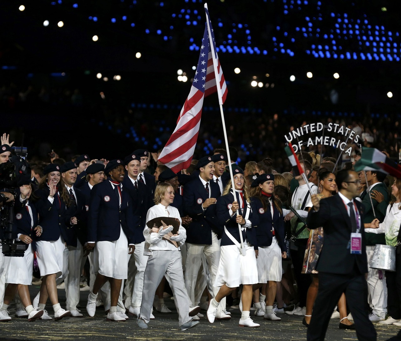 Flag bearer Mariel Zagunis of the United States holds the national flag as she leads the contingent in the athletes parade during the opening ceremony of the London 2012 Olympic Games at the Olympic Stadium July 27, 2012. [REUTERS/Murad Sezer]