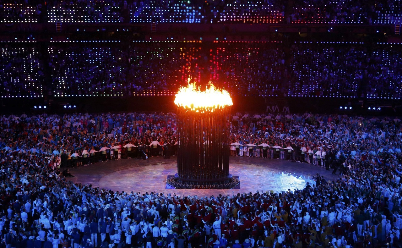 reuters:  The Olympic cauldron is seen alight during the opening ceremony of the London 2012 Olympic Games at the Olympic Stadium July 27, 2012. [REUTERS/David Gray] The London Games: Live blog | On Twitter | On Facebook | iOS app