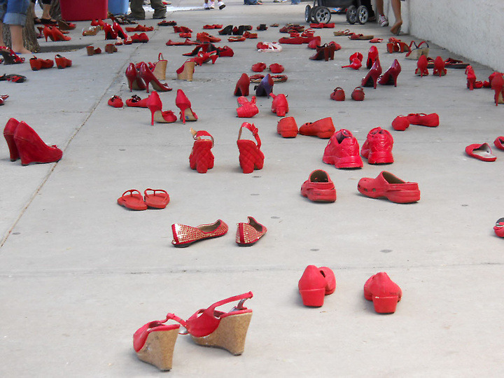 "farahjoon:  thepeoplesrecord:  Red shoes display protests violence against women in MexicoJuly 27, 2012 Mexican visual artist Elina Chauvet placed red shoes in front of the Mexican consulate today in El Paso as an artistic protest against violence against women in Juárez. More than 200 shoes - from toddler boots to high heels - covered the sidewalk on the west end of the building, where people had lined up to conduct transactions at the consulate. The 'Zapatos Rojos' (Red Shoes) art collective is a call to stand in solidarity with the escalating violence against women in Juárez,"" said Chauvet, as she continued to place shoes on the ground. ""This display is intended to give visibility to an issue that is no longer receiving the attention it merits. It's also a way for anyone in the public to participate."" Mexican officials said about 700 girls and women have been murdered in Juárez since 1993, with the numbers increasing since the drug cartel wars intensified four years ago. An uncertain number are missing. Source  FOR THE RECORD, it's called FEMINICIDE FEMINICIDE has taken place on the border (i.e., El Paso and Ciudad Juárez) since 1992 NEVER BELIEVE THE DATES AND NUMBERS THEY GIVE YOU EVERYONE IS IMPLICATED IN THIS THOUSANDS OF WORKING-CLASS WOMEN OF COLOR HAVE DISAPPEARED BUT NOBODY FUCKING CARES BECAUSE #NAFTA #ICE #GLOBALIZATION #SNUFF #MAINSTREAM MASS MEDIA #THE POLICE #THE STATE LEARN MORE NOW THIS IS SO FUCKING IMPORTANT, PLEASE TAKE A SECOND TO READ ABOUT THIS"