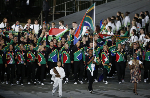 "fishingboatproceeds:  athertoned:  Caster Semenya carried the flag for South Africa, following three years of hardship. Caster was banned from competing in 2009 after doubts were raised about her gender. She was allowed to race again in 2011, and qualified for the London games. She's a favourite to win the women's 800m race.  It's great to see her back in competition, and being chosen to carry her nation's flag. Go Caster!  (n.b. Track and field authorities questioned Semenya's sex, not her gender.) I was so psyched to see Caster Semenya hold the flag for South Africa. But I remain concerned about the IOC trying to define femaleness by testosterone level. As Jordan-Young points out, ""If it's unfair to have testosterone levels higher than other athletes, why not limit men's levels, too?"""