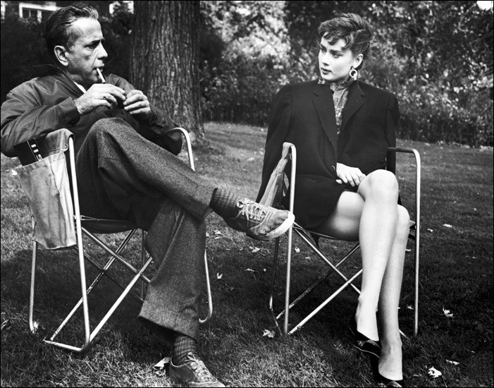 theniftyfifties:  Humphrey Bogart and Audrey Hepburn on the set of 'Sabrina', 1953.