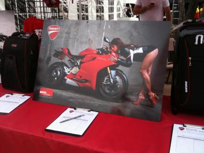 Look! My photography made it to MotoGP! I had to share this immediately- my friend Justin Kwong in CA sent me this photo from Laguna Seca… a photo from the MotoCorsa 1199 Panigale shoot made it to print for the Make-A-Wish foundation! Kylie Lewallen gives the Panigale a little kiss. Two beauties, for sure! Happy happy, joy joy! Special thanks to MotoCorsa.
