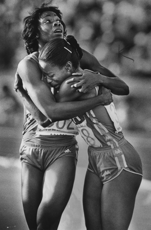 coolchicksfromhistory:  After winning the 100 meters in the Los Angeles Olympics, Evelyn Ashford (right) hugs teammate Jeanette Bolden. August 6, 1984. In addition to the 100 m, Evelyn won the 4 x 100 m relay in 1984.  She returned to the Olympics in 1988 and 1992, winning two gold medals in the 4 x 100 m relay and a silver medal in the 100 m. Jeanette only won one gold medal, her career ended when she ruptured her Achilles tendon at the 1988 Olympic trials.  Today she is a track and field coach at UCLA.