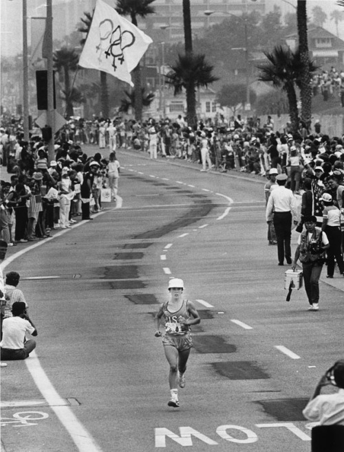 "Until 1984, the Olympic program for women did not include running events longer than 1,500 meters, in part because of the outdated belief that they were too ""fragile"" for such distances. In the inaugural women's marathon, Joan Benoit put an end to such talk as she raced away from her chief rival, Norway's Grete Waitz. Spectators lined the 26.2-mile route to cheer on the competitors, the exception being a three-mile stretch along the Marino Freeway that was closed to the public. Joan is featured as one of the congratulatory voices on the Nike+iPod."