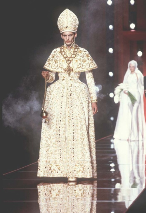 "christian dior haute couture s/s 2000, a collection that caused controvorsy and was nicknamed 'hobo couture': ""I love the decadence,"" said Galliano of the collection, who had been inspired by seeing hoboes on his daily jog by the Seine to create taffeta patterned with newsprint (the International Herald Tribune's fashion pages, no less!) and characters from Diane Arbus photographs of disconnected people on mean streets. in this Dior collection, Galliano went back to his roots: to the maniacal mix of sex, romanticism and chaos of his own early collections. This is, in a way, what Dior hired Galliano for: to make headlines and images, to shock and shake-up. via"