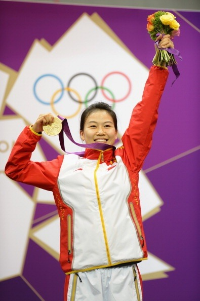 olympics:  Congratulations to Siling Yi of CHN for winning the first gold medal of the London 2012 Olympic Games in the 10m Air Rifle Shooting Final on Day 1 Photo by Lars Baron/Getty Images