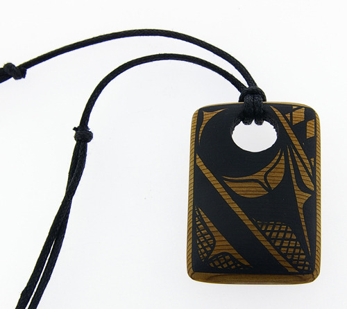 "fyeahindigenousfashion:  red cedar pendant, Rod Smith (Kwakwaka'wakw) Rod (Galuyagmi ""Great First Birth"") was taught by his father Harris Smith (Lalkawilas). He often works in basswood, red and yellow cedar, arbutus and maple. Rod is perhaps best known for his precise and elegant painting style. His pieces include: sculptures, masks, poles, original paintings, plates, vessels, bowls and bentwood boxes. In 2005, Rod was featured in the 'Changing Hands: Art Without Reservation 2' exhibition that opened at the Museum of Arts and Design in New York."