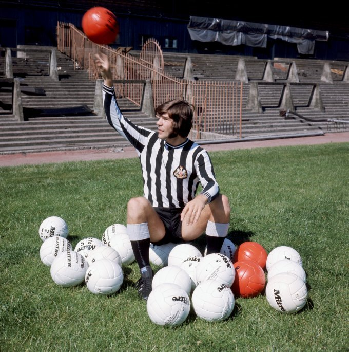 awkwardfootballphotoshoots:  Malcolm MacDonald is delighted to find a football… in a pile of footballs