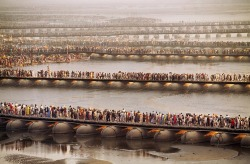 Steve McCurry's, 'Simple act of waiting- Crowds at the Kumbh Mela await their turn to bathe in the Ganges.' (x)
