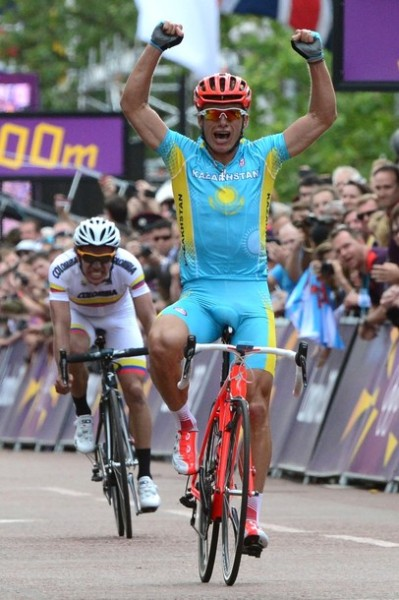 fuckyeahcycling:  Kazakhstan's Alexandre Vinokourov (L) celebrates as he crosses the finish line ahead of Colombia's Rigoberto Uran to win the men's cycling road race event in London during the London 2012 Olympic games on July 28, 2012. (via Photo from Getty Images)