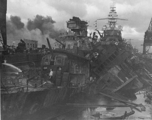 December 7, 1941: Heavy damage is seen on the destroyers, U.S.S. Cassin and the U.S.S. Downes, stationed at Pearl Harbor after the Japanese attack on the Hawaiian island.