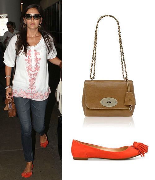 Camilla Belle arrives at LAX wearing Zara Pompom Ballerina Flats ($19.99, U.P. $49.99) and carries a Mulberry Lily bag in Oak Natural Leather (£495)